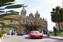 Monte-Carlo, Monaco, Casino Monte-Carlo, 25.09.2008. Casino Monte-Carlo, red Ferrari on the square, tourists photographed expensive car Royalty Free Stock Image