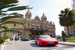 Monte-Carlo, Monaco, Casino Monte-Carlo, 25.09.2008. Casino Monte-Carlo, red Ferrari on the square, tourists photographed Ferrari Stock Images
