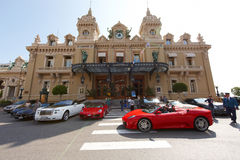 Monte-Carlo, Monaco, Casino Monte-Carlo, 25.09.2008. Red Ferrari on the square, tourists photographed Ferrari, Casino Royal, sunny day, Rolls-Royce Stock Photography