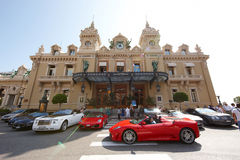 Monte-Carlo, Monaco, Casino Monte-Carlo, 25.09.2008. Casino Monte-Carlo, red Ferrari on the square, tourists photographed Ferrari, supercar, Rolls Royce Stock Photography