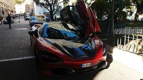 Red McLaren 720S Supercar Doors Up. Monte-Carlo, Monaco - January 25, 2019: Beautiful Red McLaren 720S Supercar, Doors Up, Parked In Front Of The Hermitage Hotel stock video footage