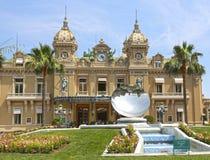 Monte-Carlo, Monaco - June 13, 2014: casino facade and a spherical sky mirror. Monte-Carlo, Monaco - June 13, 2014: casino facade, architect Charles Garnier and royalty free stock photos