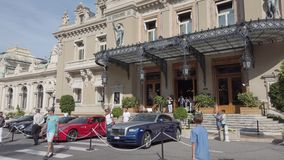 Expensive And Luxurious Cars Parked In Front Of Monte-Carlo Casino In Monaco. Monte-Carlo, Monaco - June 20, 2019: Expensive And Luxurious Cars Ferrari, Rolls stock footage