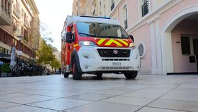 Fire Department Ambulance In Monaco. Monte-Carlo, Monaco - March 31,  French Red And White Fire Department Ambulance Front View Van Parked In The Street Of stock video