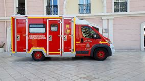Fire Department Ambulance Side View. Monte-Carlo, Monaco - March 31,  French Red And White Fire Department Ambulance Van Side View Parked In The Street Of Monaco stock footage