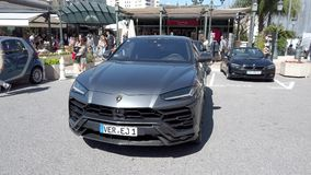 Lamborghini Urus. Monte-Carlo, Monaco - May 1, 2019: Luxury Grey Lamborghini Urus SUV Parked At Monte-Carlo Casino Square In Monaco, French Riviera, France stock footage