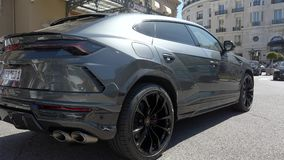 Lamborghini Urus SUV Rear View. Monte-Carlo, Monaco - May 1, 2019: Luxury Grey Lamborghini Urus SUV Rear View Parked At Monte-Carlo Casino Square In Monaco stock footage