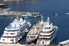 Monte-Carlo, passenger ship, marina, yacht, luxury yacht. Monte-Carlo is passenger ship, luxury yacht and ship. That marvel has marina, water transportation and stock image