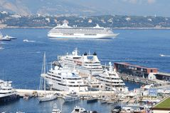 Monte-Carlo, passenger ship, marina, cruise ship, water transportation. Monte-Carlo is passenger ship, water transportation and yacht. That marvel has marina stock image