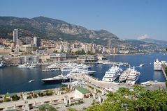 Monte-Carlo, Port de Fontvieille, marina, harbor, city, sea. Monte-Carlo, Port de Fontvieille is marina, sea and dock. That marvel has harbor, port and bay and stock photo