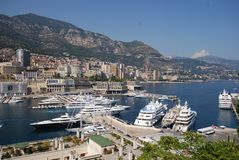 Monte-Carlo, Port de Fontvieille, marina, harbor, city, sea. Monte-Carlo, Port de Fontvieille is marina, sea and dock. That marvel has harbor, port and yacht and stock photos