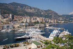 Monte-Carlo, Port de Fontvieille, marina, harbor, city, sea. Monte-Carlo, Port de Fontvieille is marina, sea and urban area. That marvel has harbor, port and stock photography
