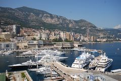 Monte-Carlo, Port de Fontvieille, marina, harbor, sea, city. Monte-Carlo, Port de Fontvieille is marina, city and dock. That marvel has harbor, port and royalty free stock photo