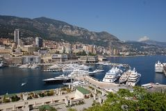 Monte-Carlo, Port de Fontvieille, marina, harbor, sea, sky. Monte-Carlo, Port de Fontvieille is marina, sky and water. That marvel has harbor, city and dock and royalty free stock photos