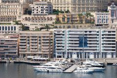 Monte-Carlo, Port de Fontvieille, marina, water transportation, urban area, city. Monte-Carlo, Port de Fontvieille is marina, city and condominium. That marvel royalty free stock photos