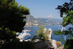 Monte-Carlo, waterway, water, sky, tree. Monte-Carlo is waterway, tree and bay. That marvel has water, lake and plant and that beauty contains sky, sea and Royalty Free Stock Photo