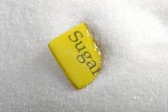 Monte do açúcar com placa e açúcar da palavra Imagem de Stock Royalty Free