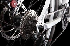Monte en bicicleta los engranajes, el freno de disco y el derailleur trasero Imagenes de archivo