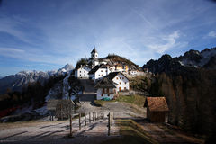 Monte Lussari. The Monte Lussari (1790 m) near Camporosso/Italia. Village in the Alps, Monte Lussari, Madonna sanctuary and Cima del cacciatore mountain stock photo