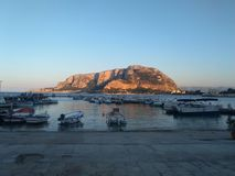 Monte pellegrino seen from the square of mondello palermo  monte erkte. Monte pellegrino seen from the square of mondello palermo. the mountain illuminated by Stock Images