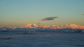 Monte rosa. View from the mountain top to a cloud layer covering the lugano lake. On the background the  Alps and the 4 634m Monte Rosa Royalty Free Stock Image