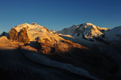 Monte Rosa and Liskamm. Summits of Nordend, Dufourspitze of Monte Rosa massif ans Liskamm, all 4000-meter-peaks in the swiss alps near town of Zermatt; at sunset Royalty Free Stock Photos