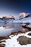Monte Rosa un picco di montagna di Lykamm al tramonto da Riffelsee Fotografia Stock
