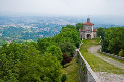 Monte Sacri chapel. Scenic view of Monte Sacri chapel on forested mountains, Lombardy and Piedmont, Italy Stock Photos