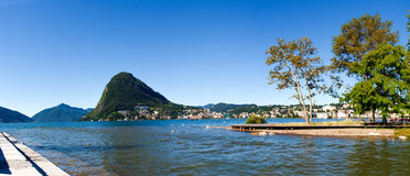Monte San Salvatore and the mouth of the river Cassarate Royalty Free Stock Photos