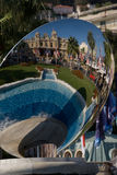 Montecarlo square reflexions view. Situated on the same square as the casino and the famous hotel de paris, on center Montecarlo ,this  sculpure mirror Royalty Free Stock Photos