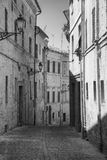 Montecassiano Macerata, Marches, Italy, historic town. Montecassiano Macerata, Marches, Italy, old buildings in the historic town. Black and white Stock Image