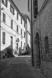 Montefano Macerata, Marches, Italy, historic town. Montefano Macerata, Marches, Italy, old buildings in the historic town. Black and white Royalty Free Stock Photo