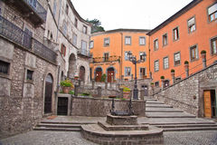 Montefiascone Viterbo Italy. A plaza with a well and the historical medieval stone dwelling Stock Photography