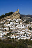 Montefrio. Small village in Andalusia, Spain. Famous for it's main church, built on top of a steep rock. The white houses shining brightly in the sun are typical Royalty Free Stock Photo