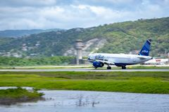JetBlue aircraft on the runway in Montego Bay. Montego Bay, Jamaica - April 11 2015: JetBlue aircraft on the runway at Sangster International Airport MBJ in royalty free stock photo