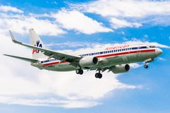 Montego Bay, Jamaica - February 19 2017: American Airlines aircraft preparing to land in Montego Bay. American Airlines aircraft with wheels down, preparing to stock image