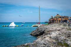 Cliffs and turquoise ocean water on tropical Caribbean island at Margaritaville Montego Bay Jamaica. Montego Bay, Jamaica - March 20 2018: Beautiful cliffside stock image