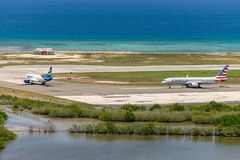 Spirit Airlines and American Airlines aircraft on runway in Jamaica. Montego Bay, Jamaica - March 27 2015: Spirit Airlines and American Airlines aircraft on stock photo