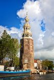 Amsterdam. Montelbaans tower on bank of the canal Oudeschans in Amsterdam, Netherlands Royalty Free Stock Photos