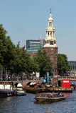 Montelbaanstoren Tower. The Montelbaanstoren is a tower on bank of the canal Oudeschans in Amsterdam, Netherlands. The original tower was built in 1516 for the Stock Image