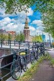Montelbaanstoren tower in Amsterdam, Netherlands. The Montelbaanstoren tower on Oudeschans canal in Amsterdam, Netherlands, built in 1516 for the purpose of Stock Photo