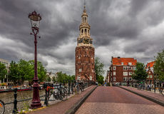 Montelbaanstoren tower under cloudy sky in Amsterdam, Netherland Royalty Free Stock Images