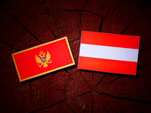Montenegrin flag with Austrian flag on a tree stump  Royalty Free Stock Images