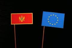 Montenegrin flag with European Union EU flag isolated on black. Background Royalty Free Stock Photography