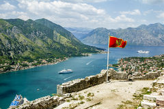 Montenegrin flag flying in the fortress wall in the old town of Royalty Free Stock Photography
