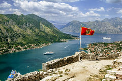 Montenegrin flag flying in the fortress wall in the old town of Stock Images