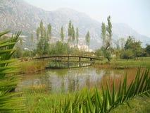 Montenegrin landscape. Lake, mountains, bridge and green grass Stock Photography
