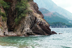 Montenegro, Adriatic sea. Early autumn, a beautiful rock on the sea background Stock Photos