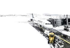 Montenegro Airlines airplane in parking position on Belgrade airport in cold winter. And heavy snow royalty free stock images