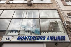 Montenegro Airlines logo on their main office for Serbia. Montenegro Airlines is the national air carrier of Montenegro. Picture of the Montenegro Airlines sign stock image